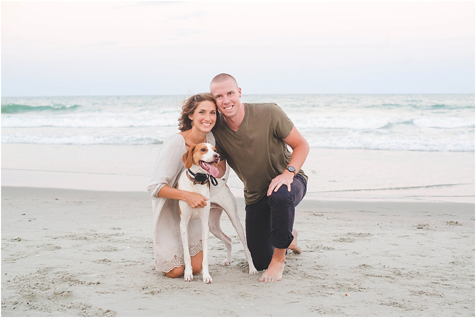 a couple with their dog for beach portraits