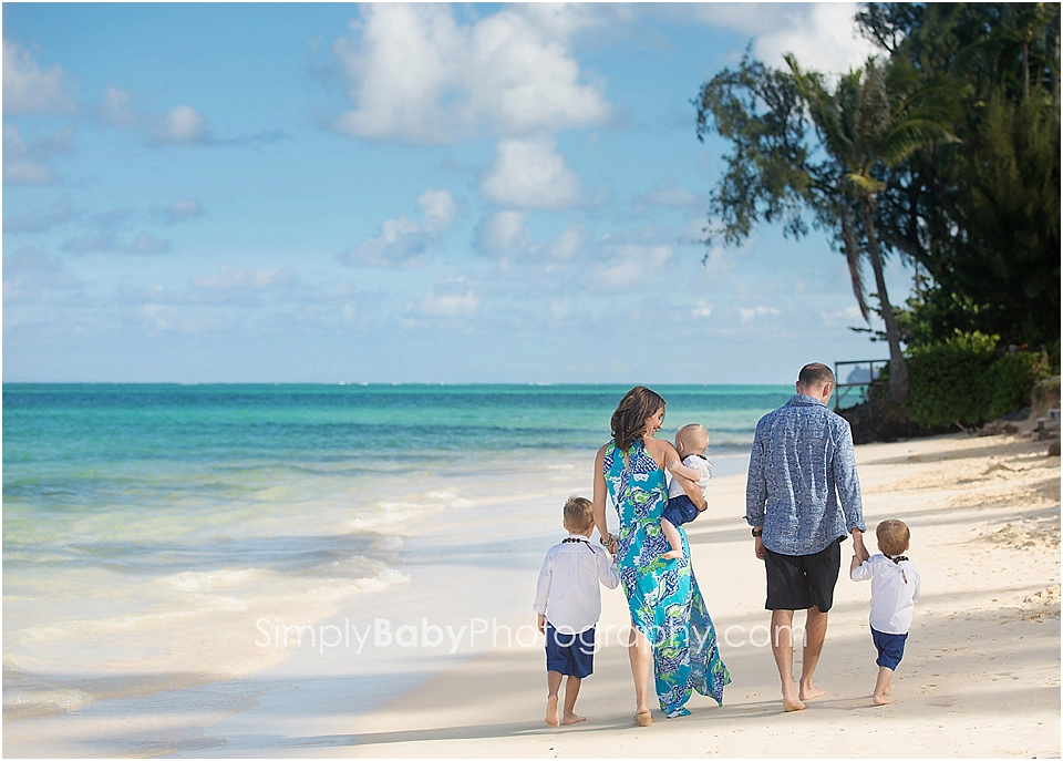 family walking on beach for pictures