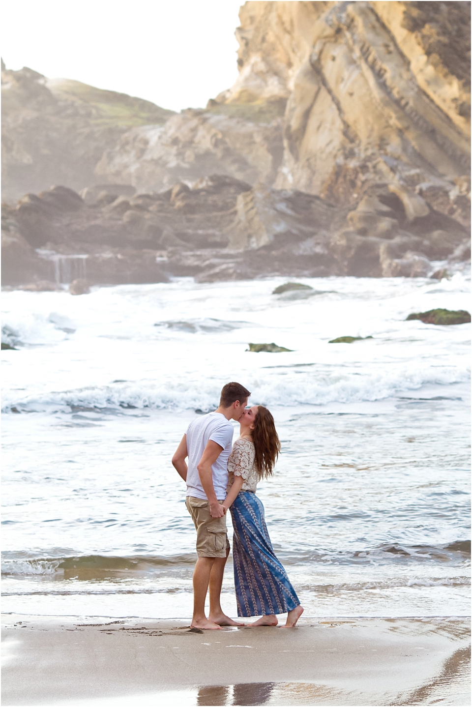 couple kissing on the beach coordinating outfits for pictures