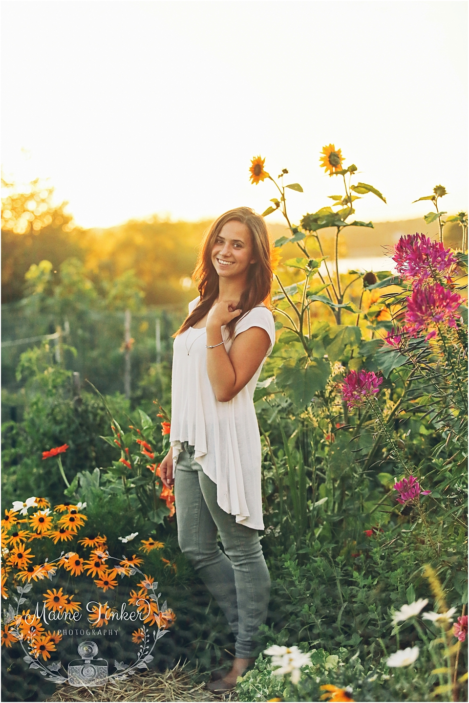 Senior girl posing in a flower field at sunset and golden hour