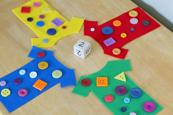 counting with buttons and a dice for preschool math