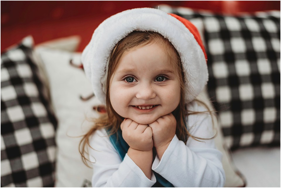 a little girl taking santa pictures