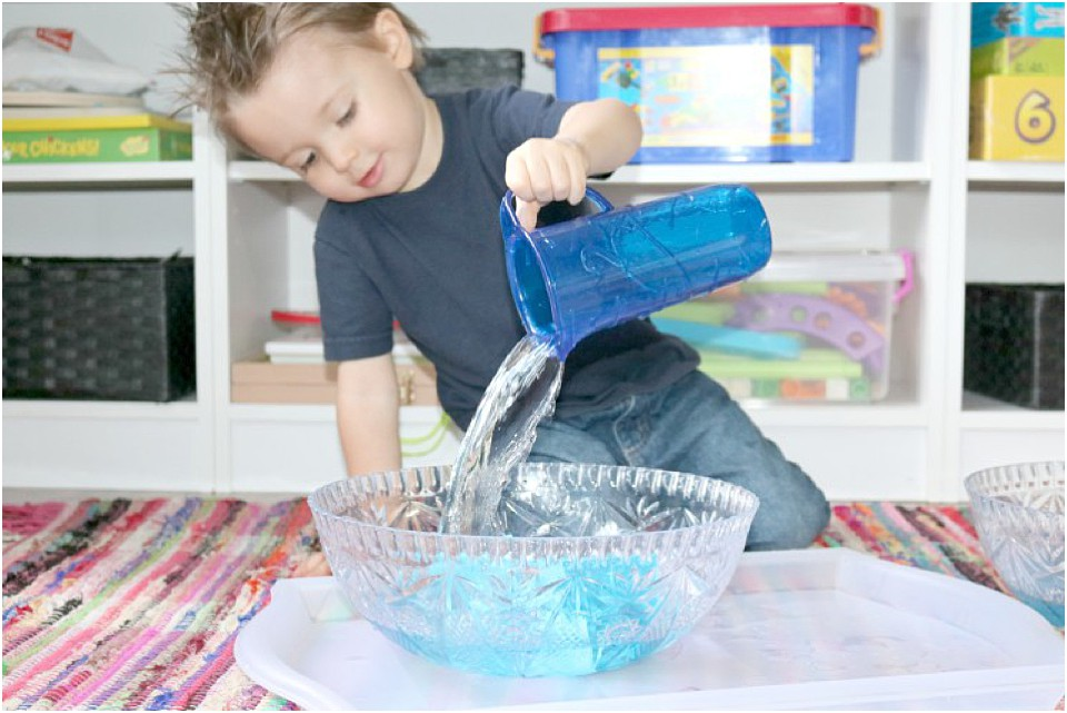preschooler pouring water into a dish
