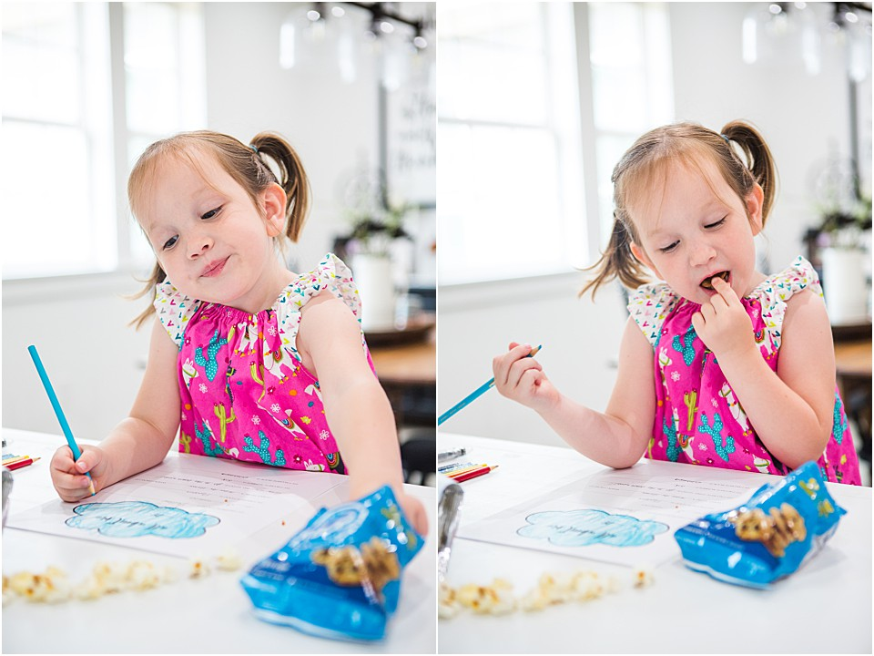 preschooler eating NICE snacks from Walgreens