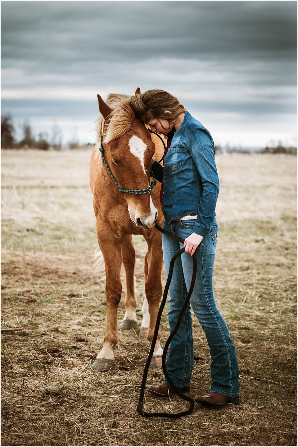 teen girl posing with horse for pictures