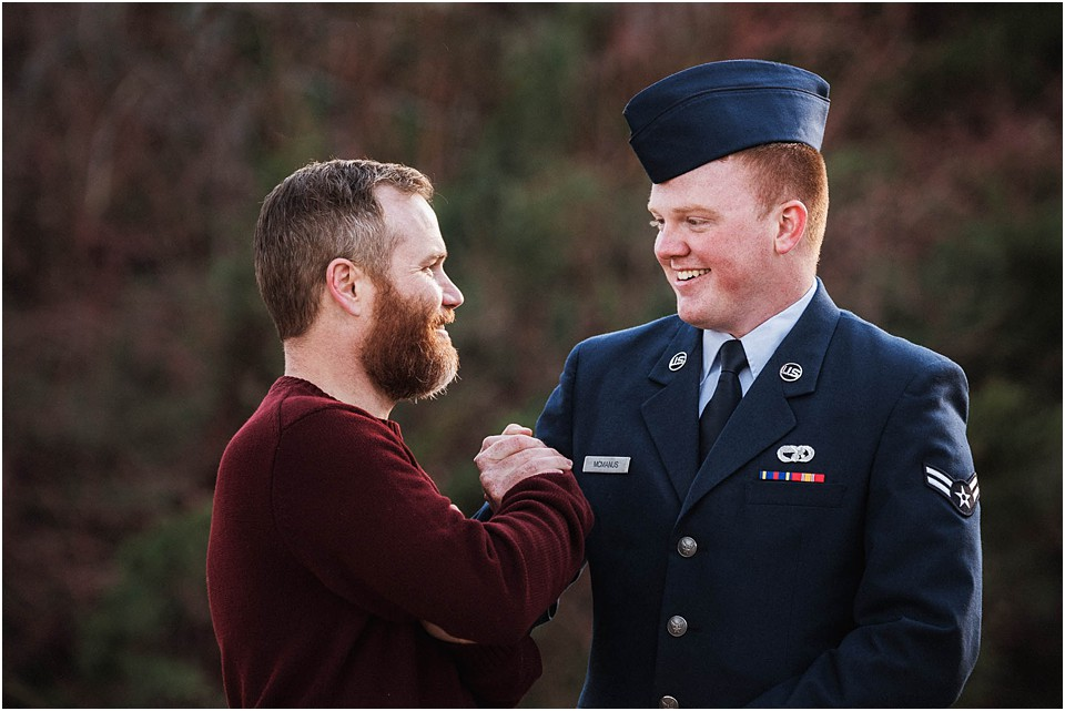 dad congratulating teen son in military