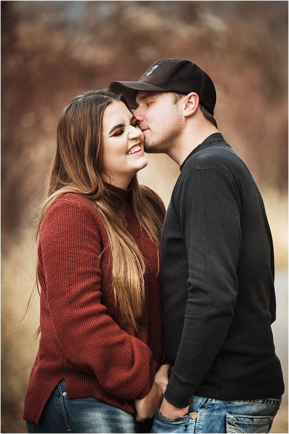 couple with guy kissing girl on the cheek