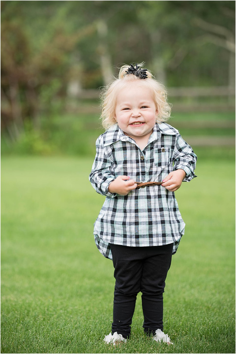 little girl smiling for pictures for scrunched nose
