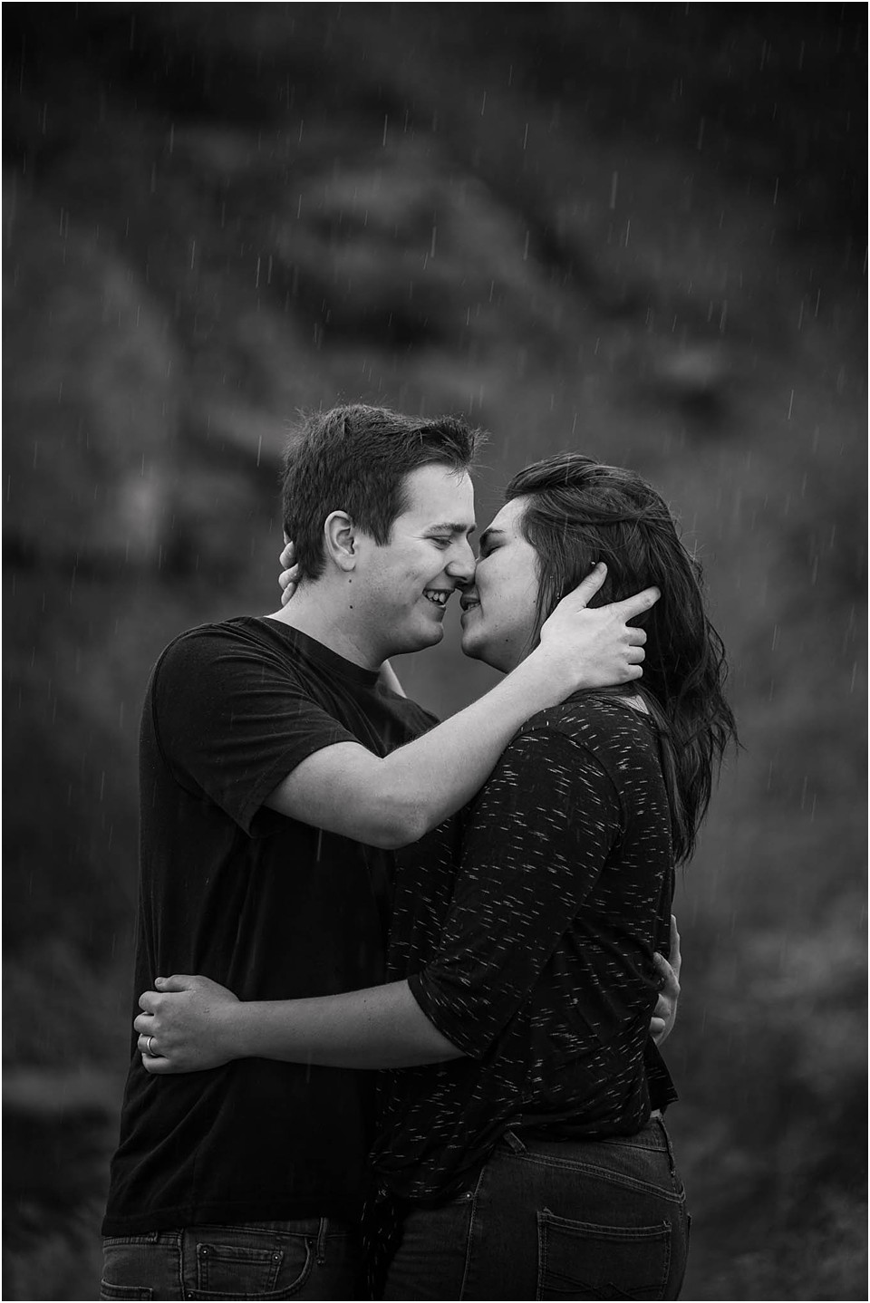 a couple about to kiss for pictures