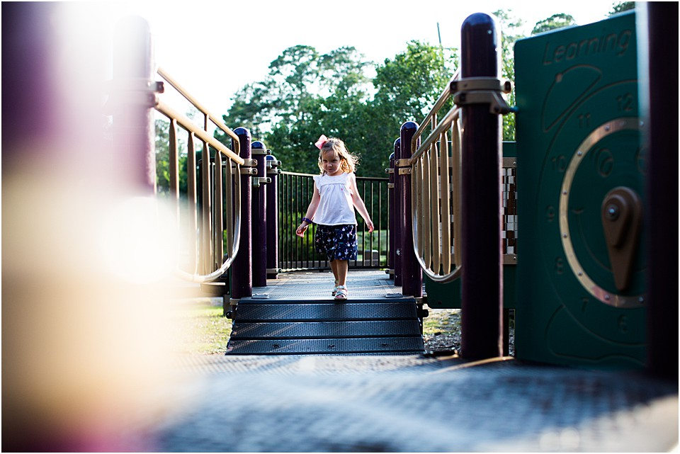 preschool girl running on a playground