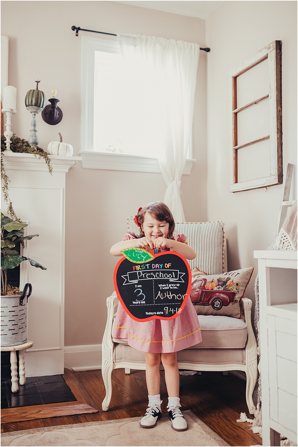 preschool girl holding sign for back to school