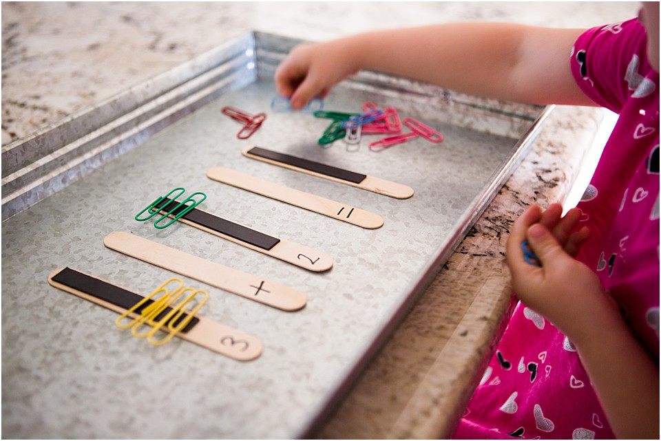 Preschool Math addition problem using science materials of magnets and metal