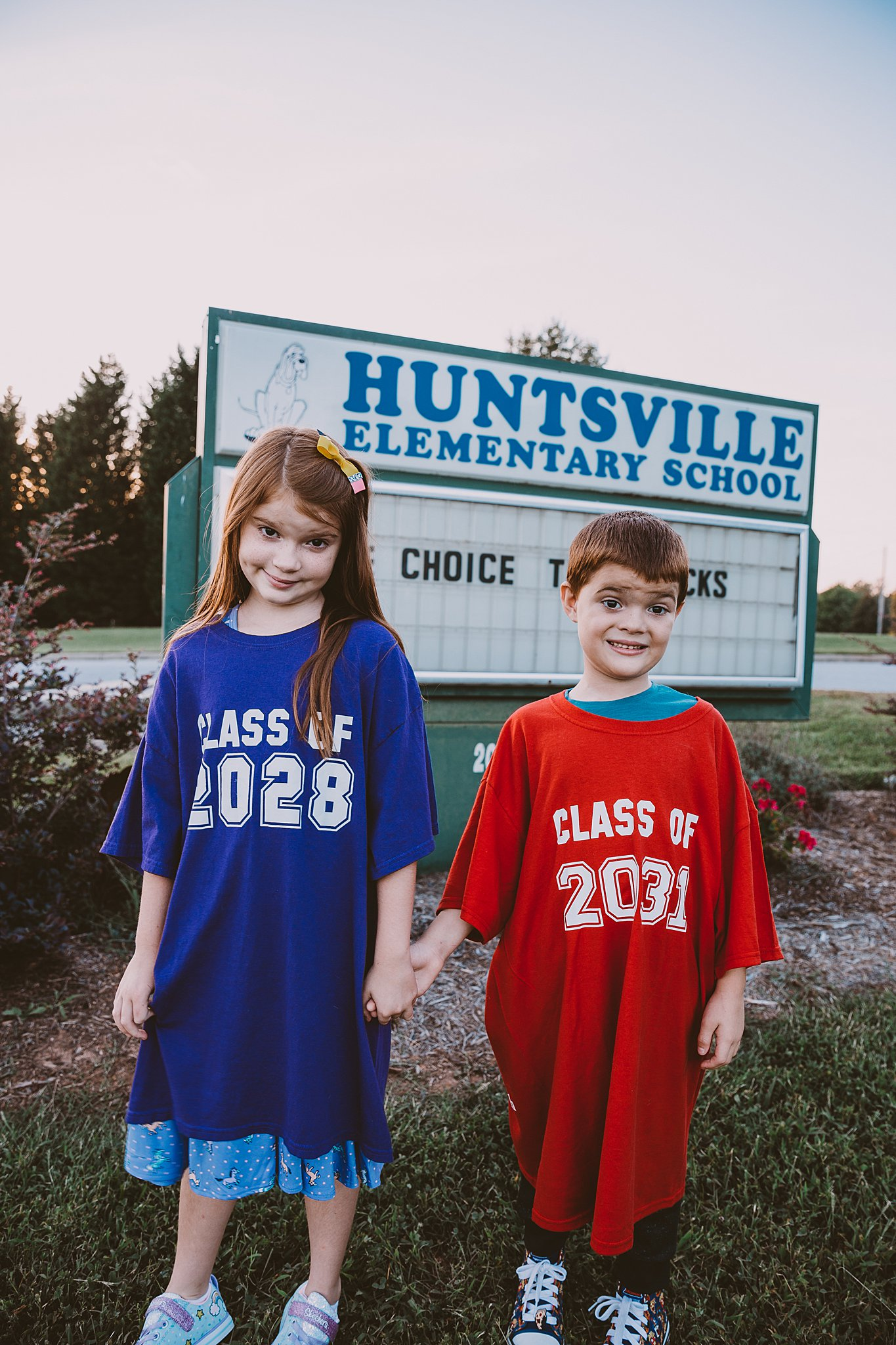 kids in class of t shirts for a first day of school picture