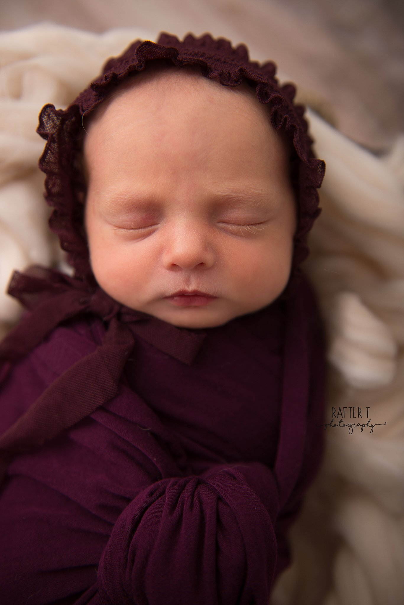 newborn baby girl with bonnet and swaddled for DIY baby pictures