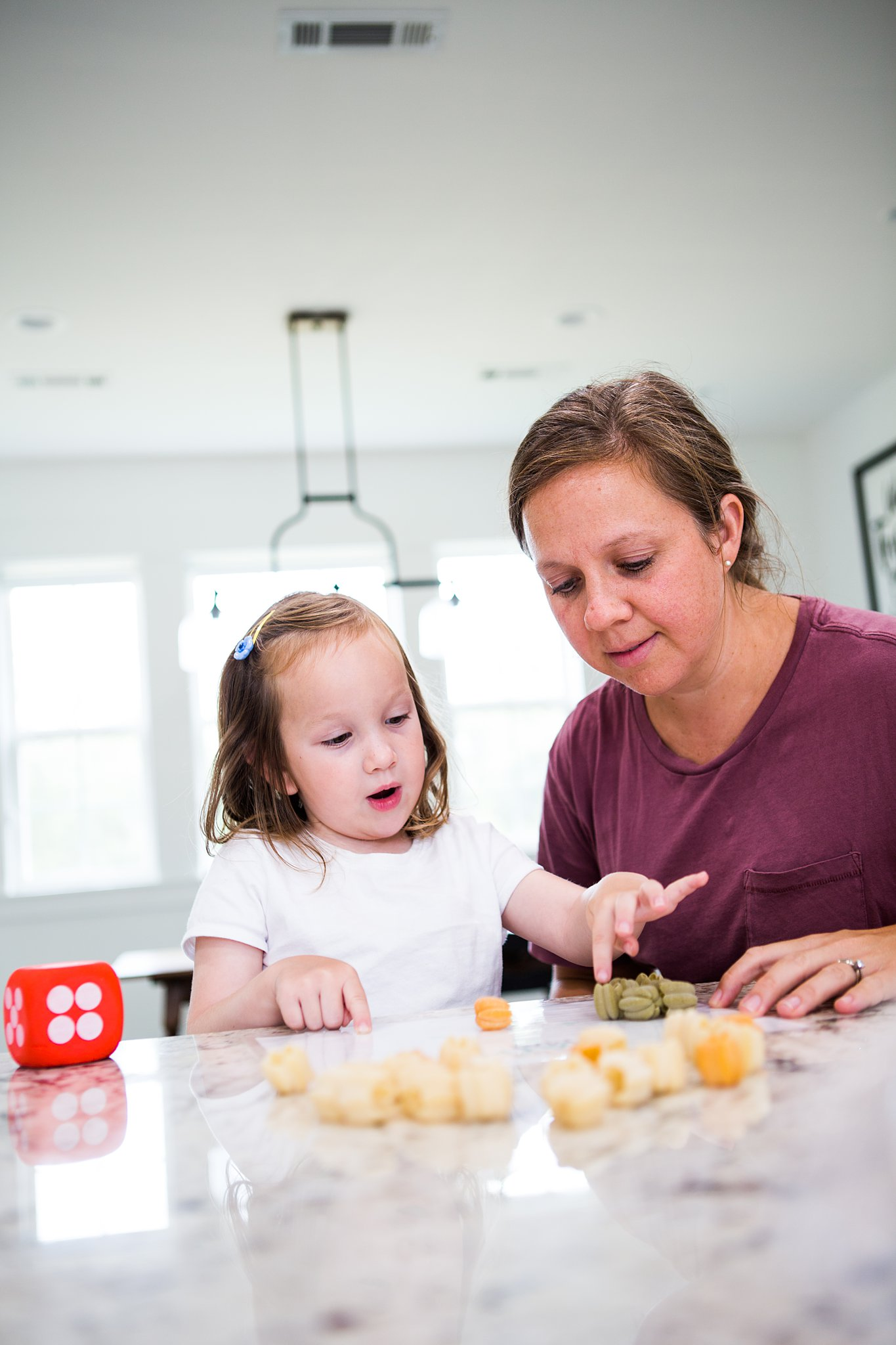 mom and daughter playing a pumpkin math game