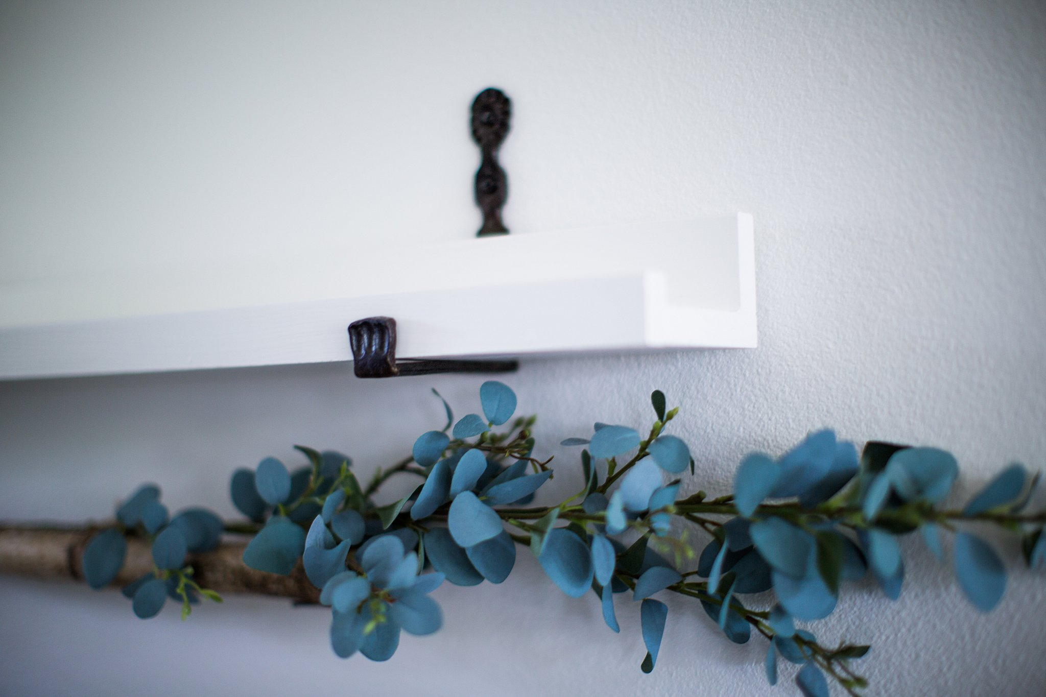 floating shelf with hand forged brackets