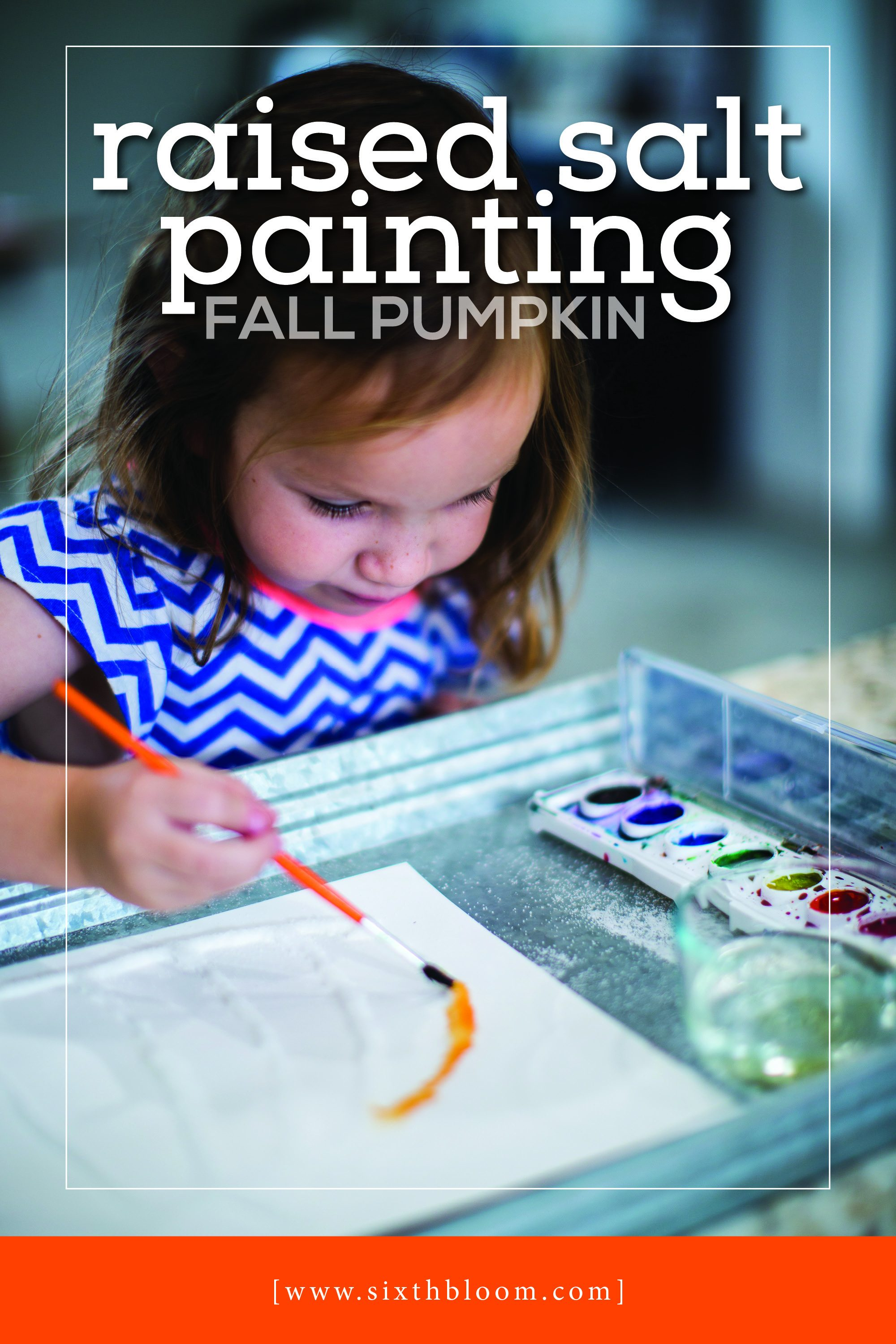 preschooler painting a salt pumpkin for art lessons