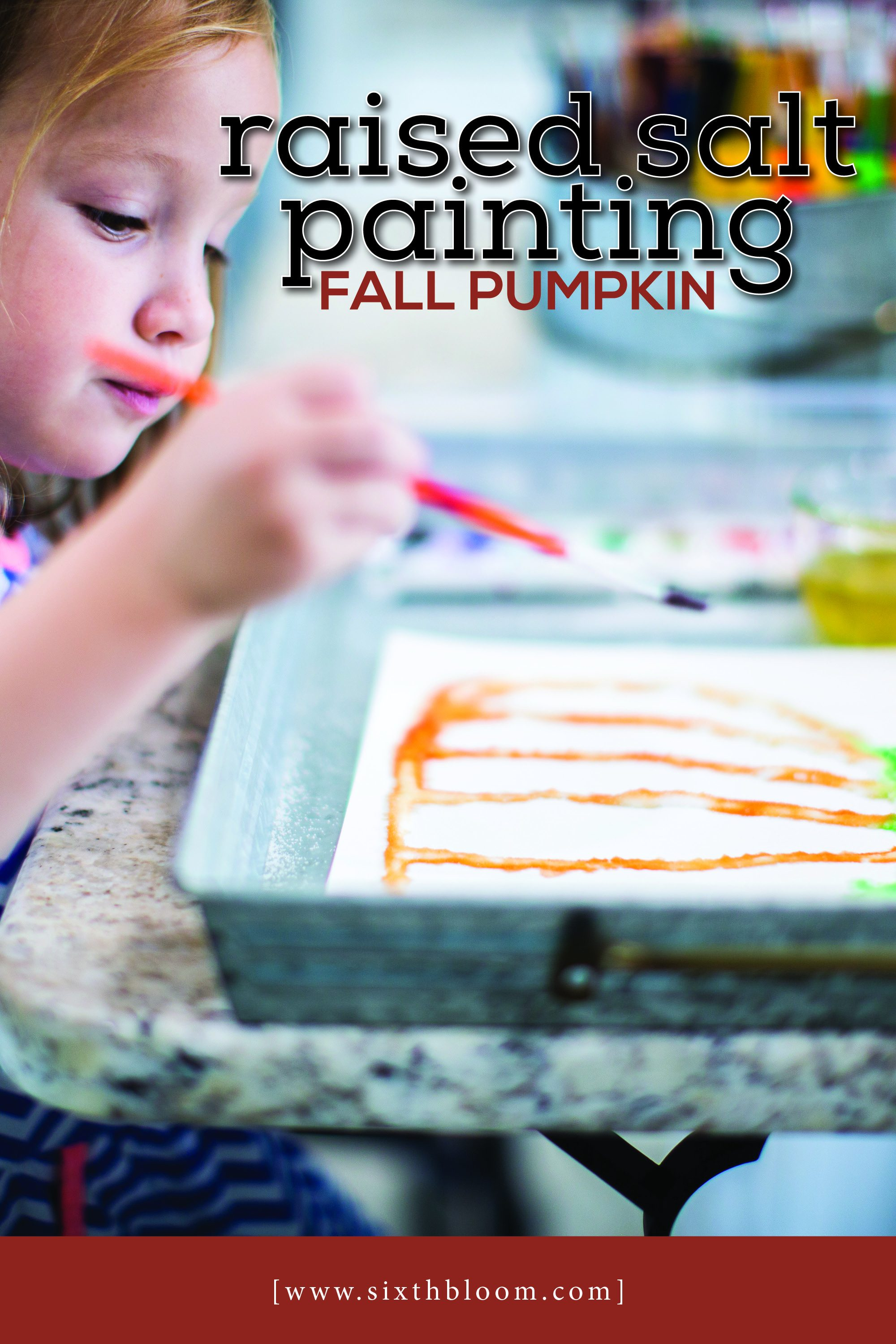 preschooler painting a pumpkin with watercolor and salt