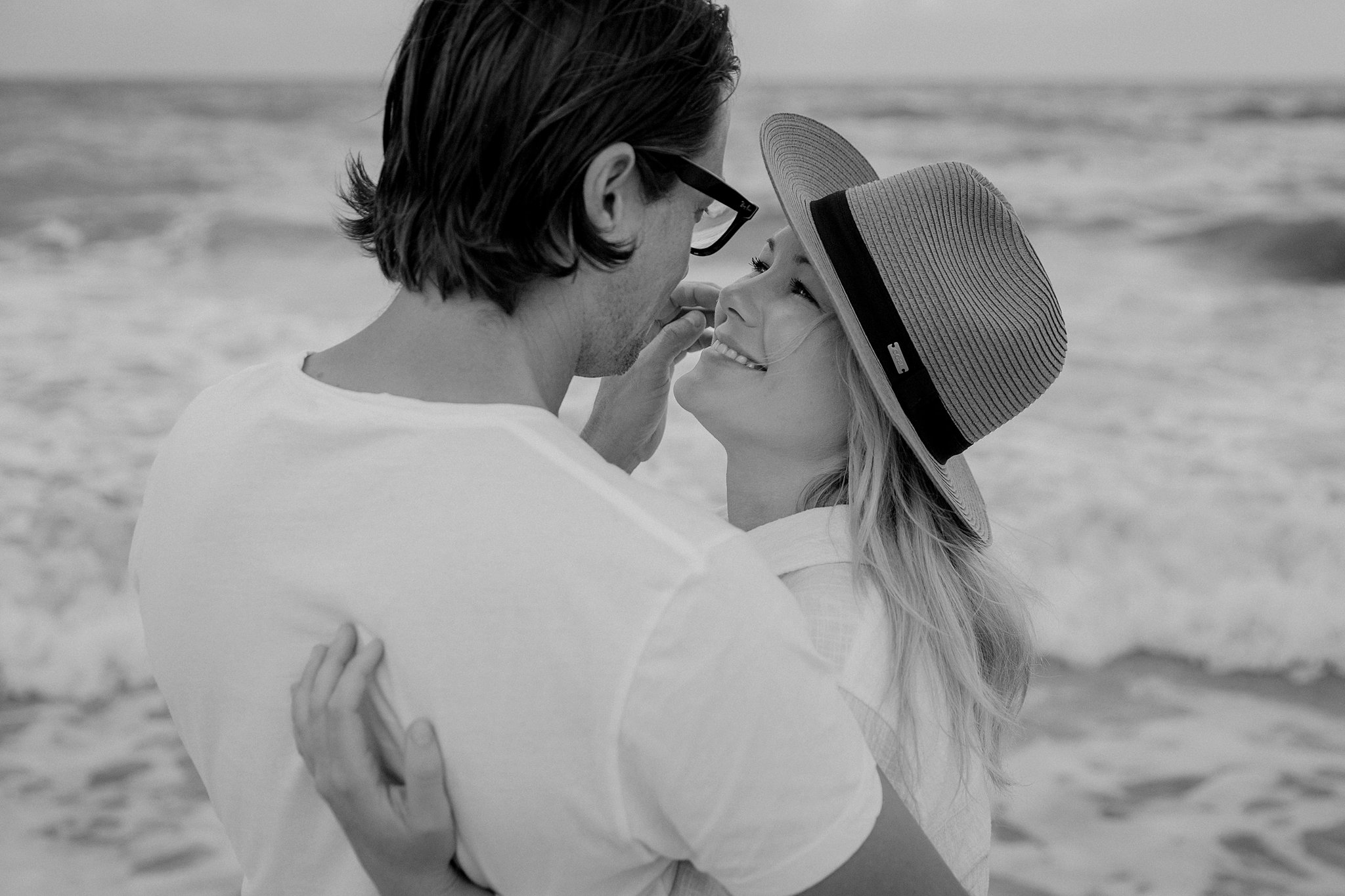 engagement session picture of couple on beach