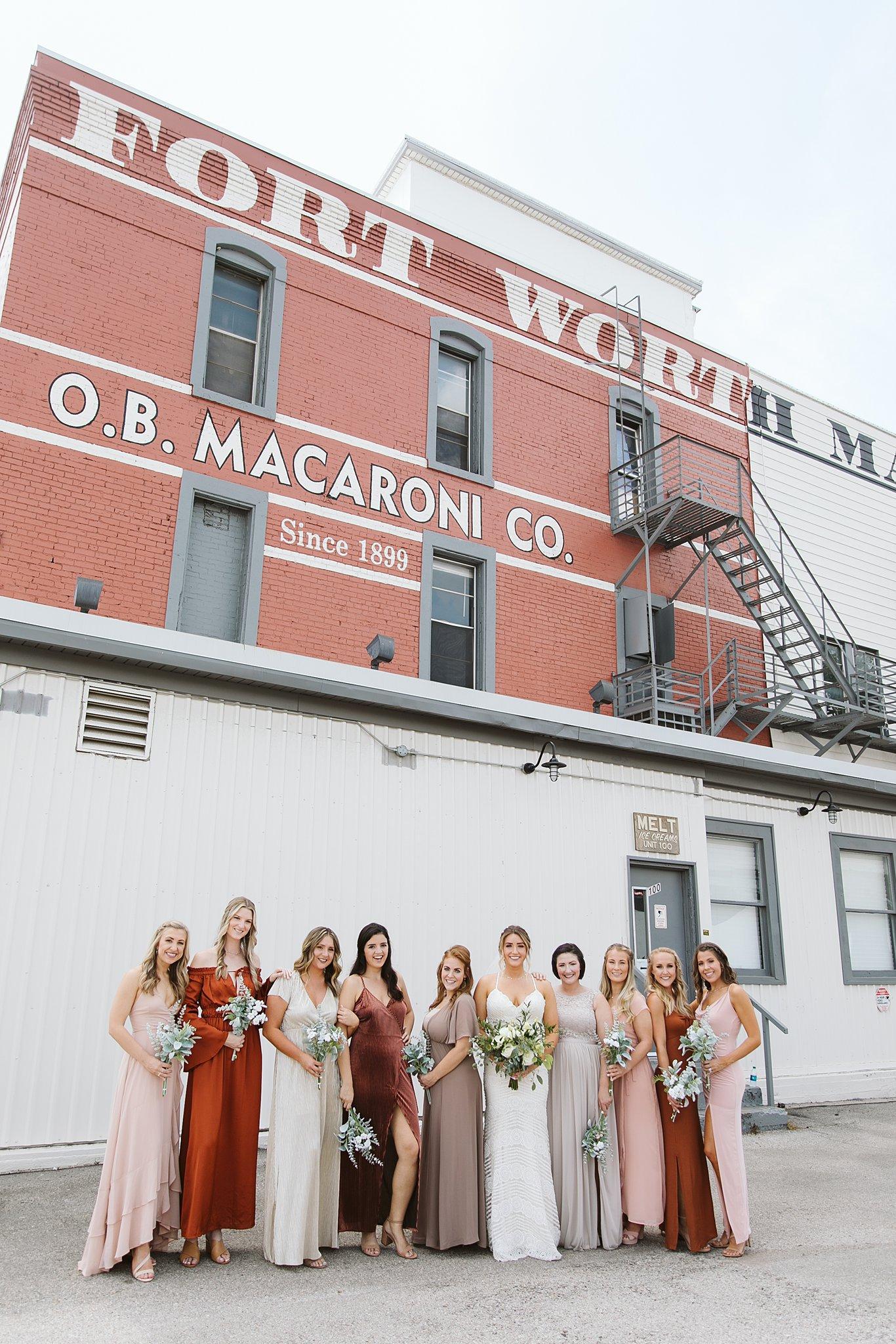 bride and bridesmaid in an urban location