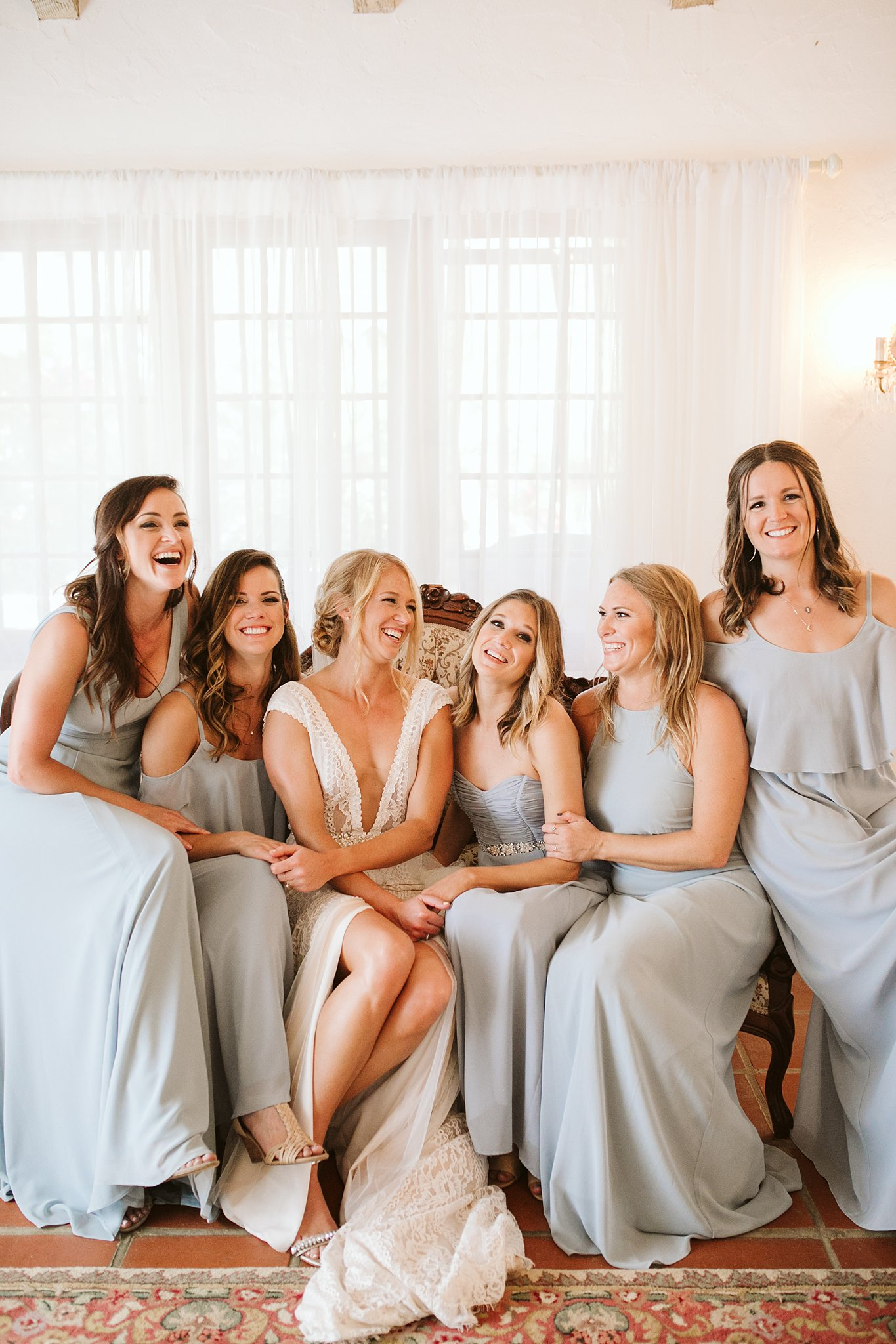 bride and bridesmaids posing for pictures