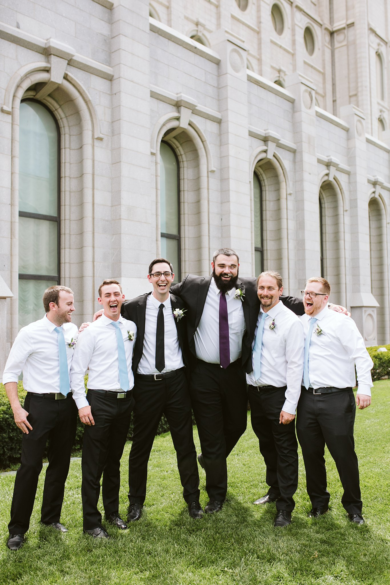 groom and groomsmen laughing for wedding party photos