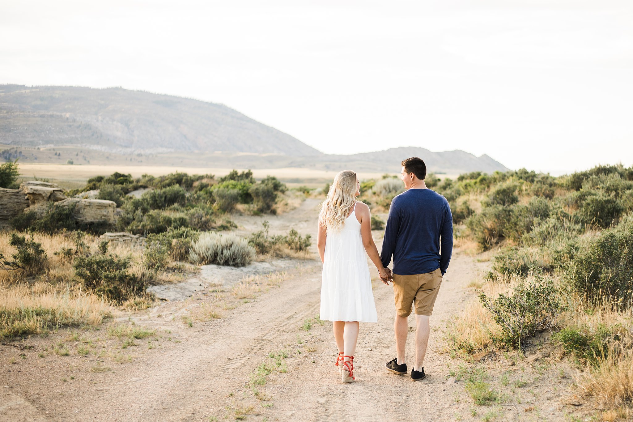 engagement photography of a couple walking hand in hand