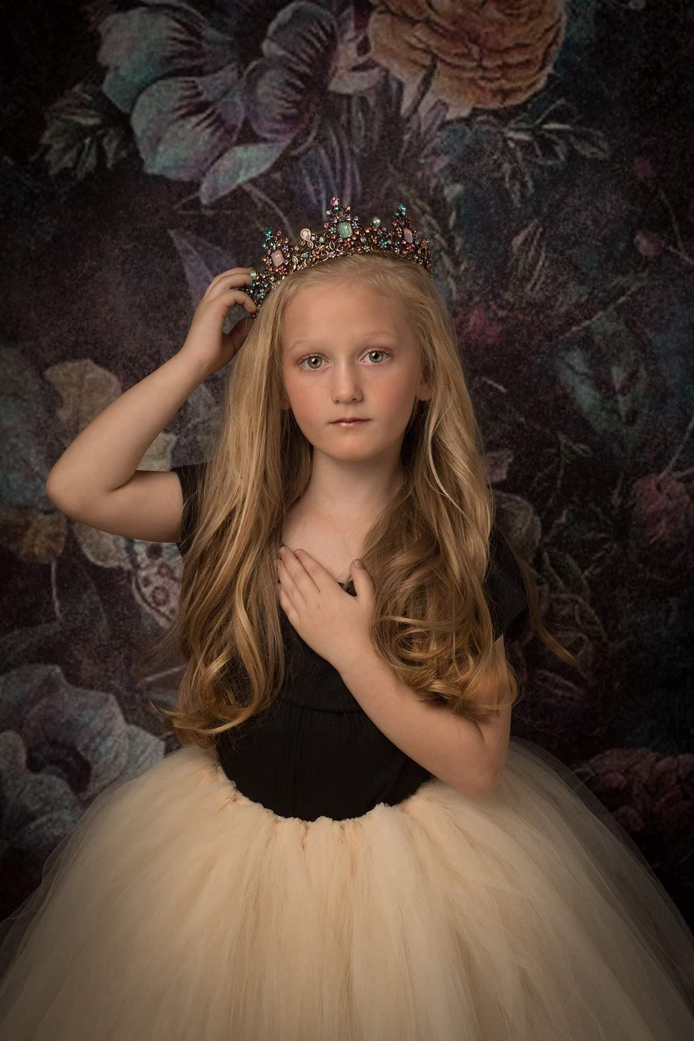 ballerina posing with her crown and tutu