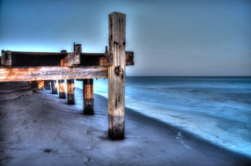 HDR image processed in photoshop of a pier and water