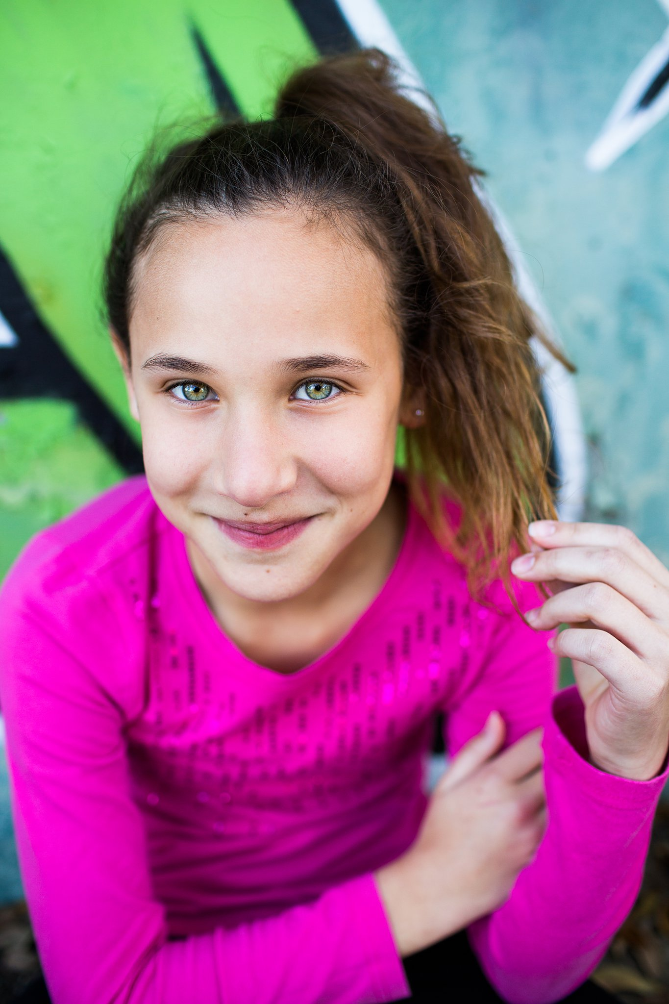 dance headshots for a young girl in front of a graffiti wall