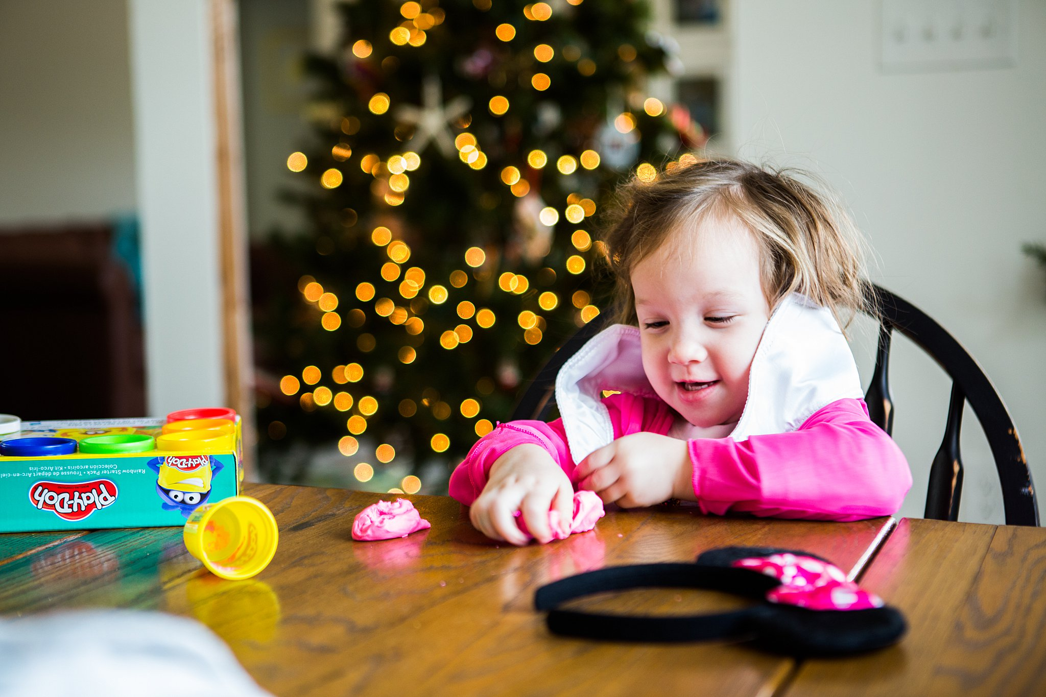 toddler playing with Christmas gifts
