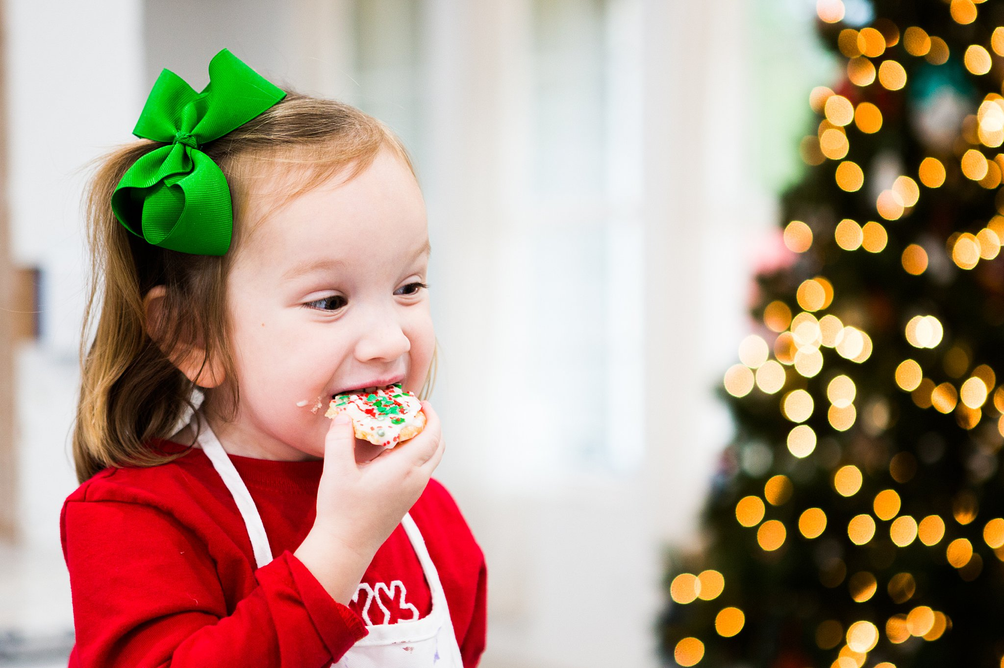 toddler eating christmas cookies