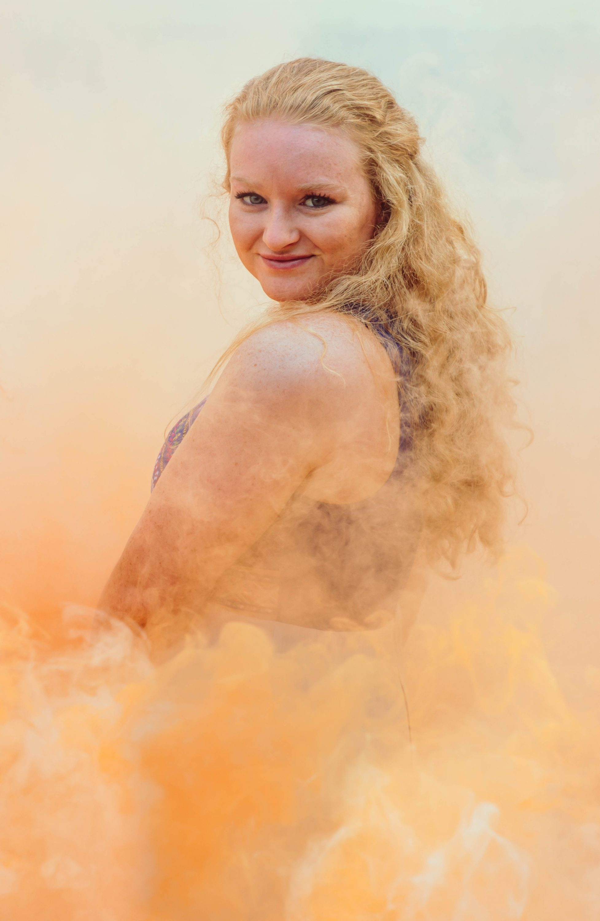 orange smoke bomb with a senior portrait