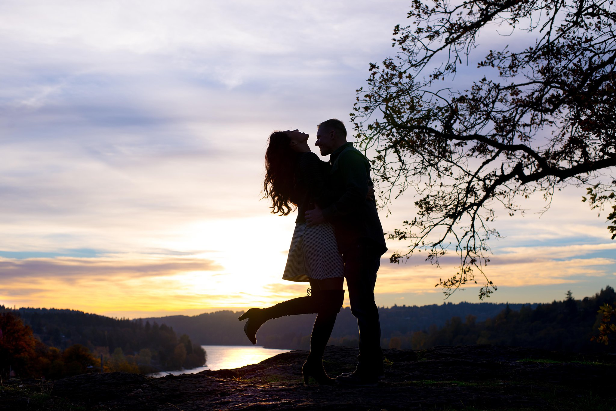 picture of a couple silhouette on top of a mountain