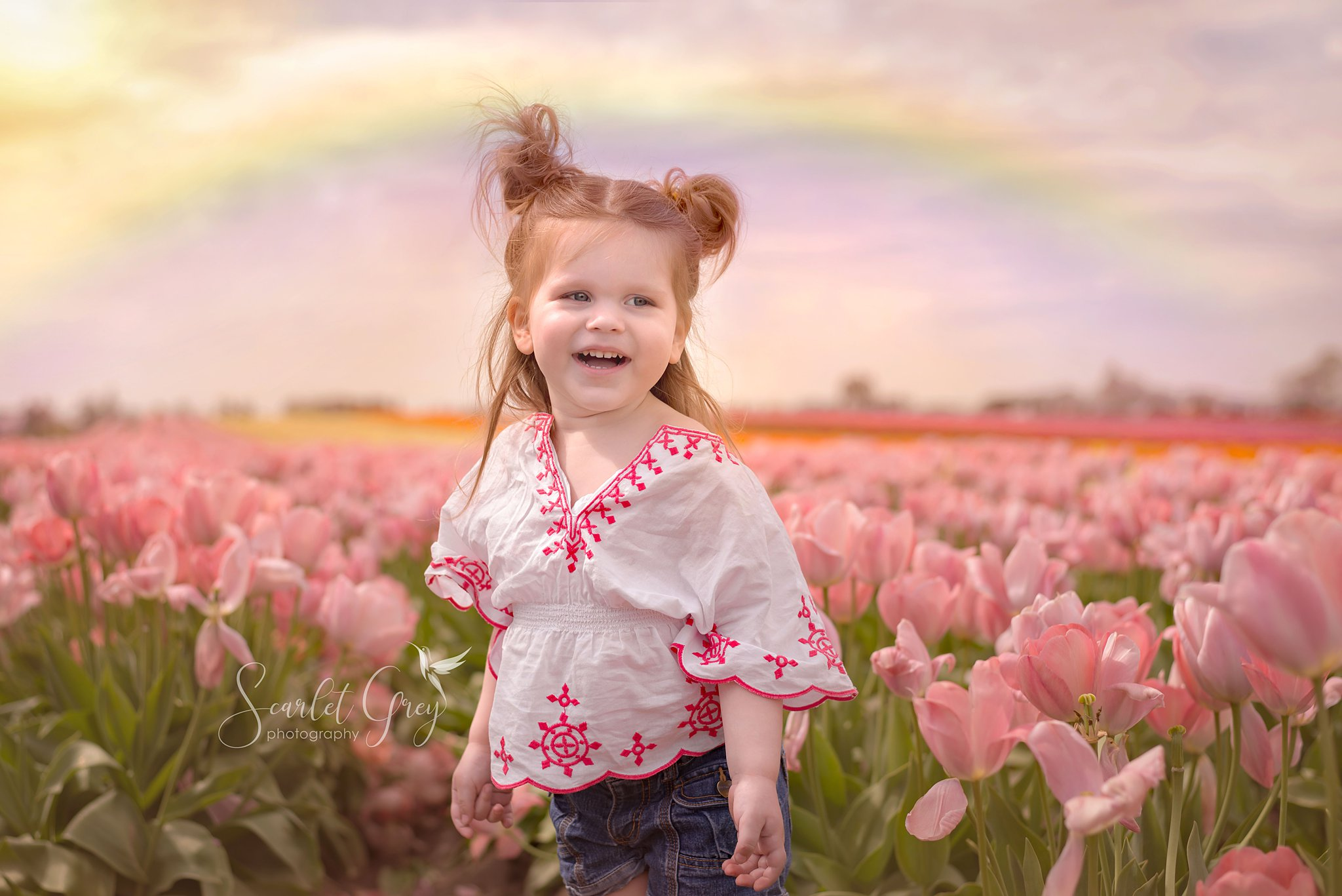 portrait of a little girl in a tulip field