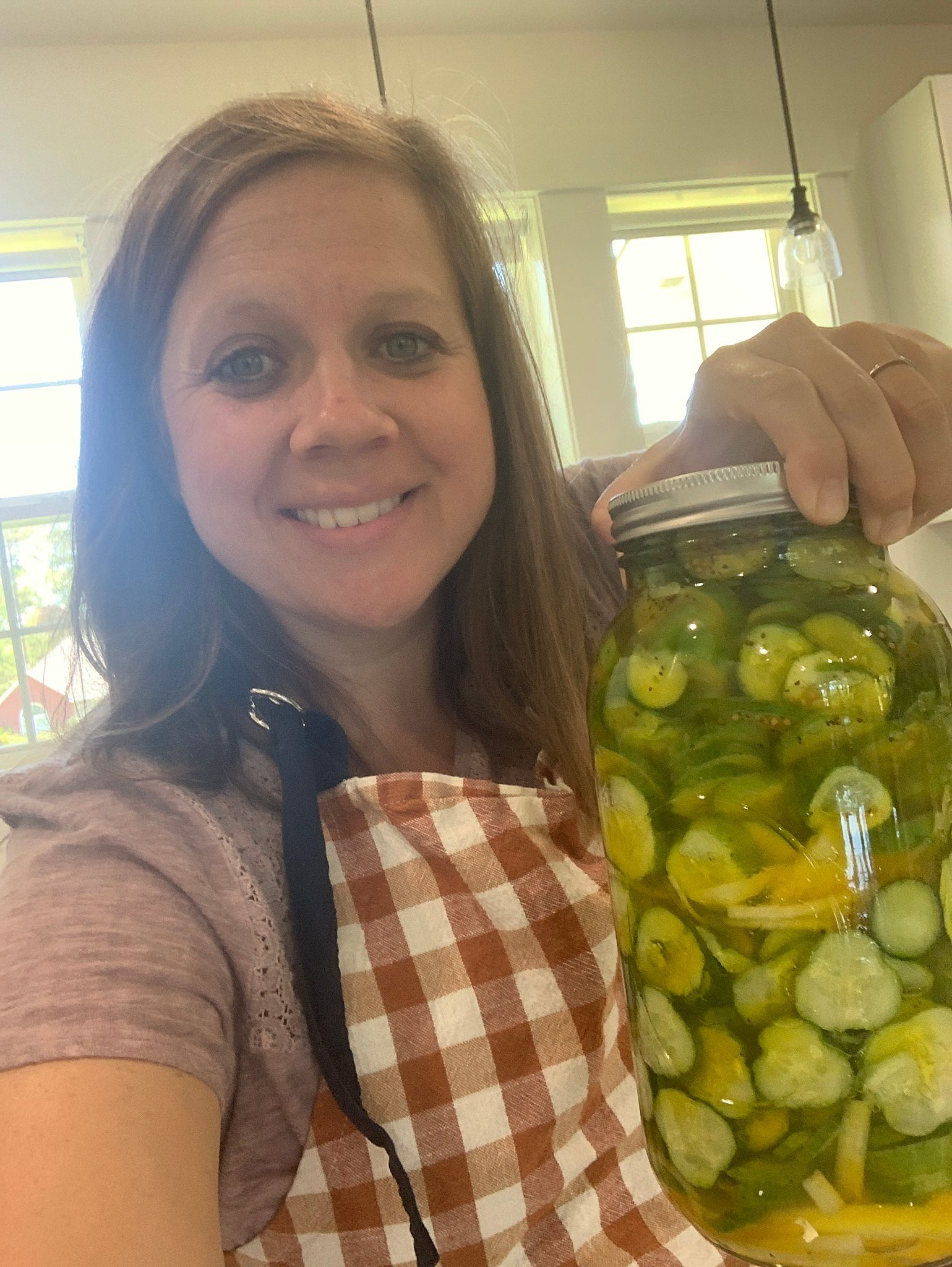 jar of sweet pickles for learning to can and preserve